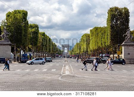 Paris, France - July 27 2019: Traffic On Champs-elysees With Arc De Triomphe In Background. Shot Fro