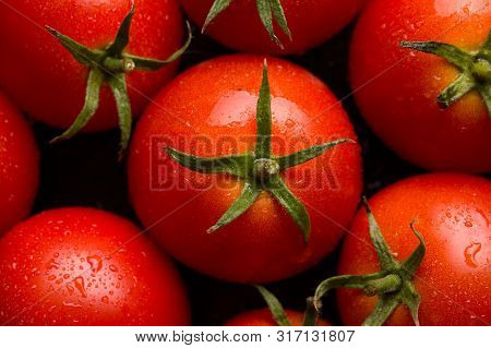 Red Tomatoes Background. Tomatoes Top View. Ripe Tomatoes Close-up.