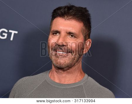 LOS ANGELES - AUG 13:  Simon Cowell arrives for the America's Got Talent' Season 14 Red Carpet on August 13, 2019 in Hollywood, CA