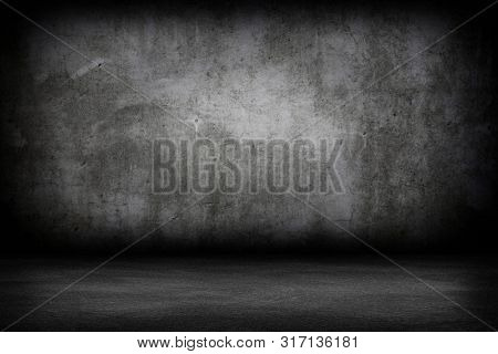 Grunge interior room with concrete wall and floor. Empty concrete space.