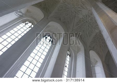 Gdansk, Poland - August 12, 2019: Interior of St. Mary's Basilica of the Assumption of the Blessed Virgin Mary in Gdansk, the Crown Gdansk is Europe's Largest Temple Built of Brick