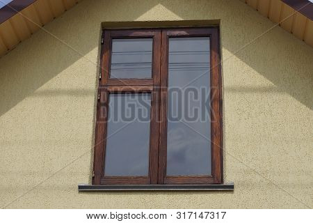 Brown Wooden Window On The Gray Wall Of The House