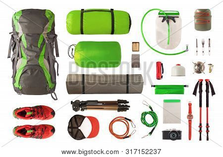 Top View Of Sport Equipment And Gear For Trekking And Camping. Collection Of Cookware, Sleeping Bag,