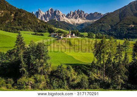Santa Maddalena Church And Geisler (odle) Dolomites Mountain Peaks  - Val Di Funes, South Tyrol, Ita