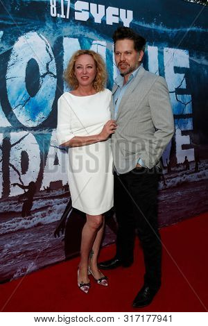 LOS ANGELES - AUG 12: Virginia Madsen, NIck Holmes at the Premiere Of SyFy's