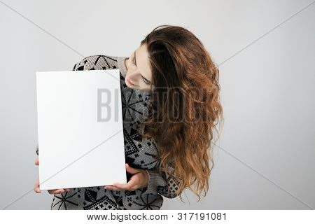 Girl And Blank Canvas. Copy Space On Canvas Board For Image Or Message. Young Woman Looking At Mocku