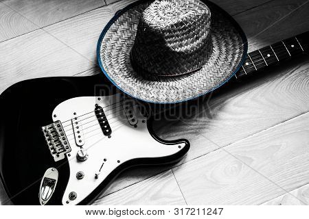 American Culture. Country Music Concept Theme With A Cowboy Hat And Electronic Guitar On A Wooden Fl