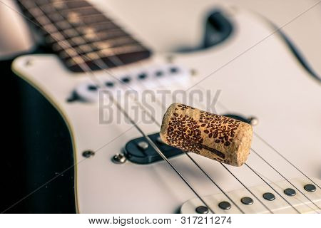 Black And White Electronic Guitar Close Up View. Details Of Rock Guitar. Wine Cork On Guitar Strings