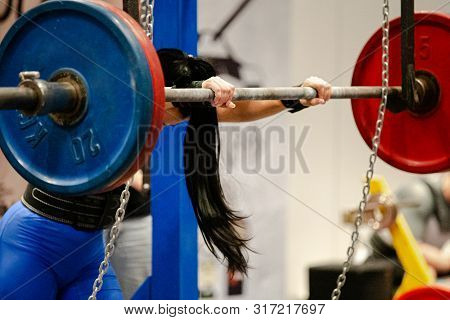 Female Powerlifter Squat Exercise At Powerlifting Competition