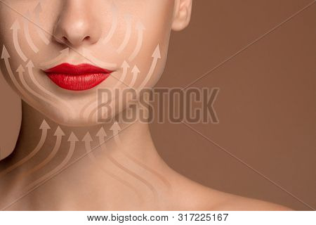 Beautiful Female Face Isolated On Brown Background. Concept Of Bodycare, Cosmetics, Skincare And Lif