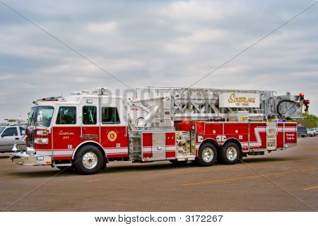 New hook and ladder fire truck sits