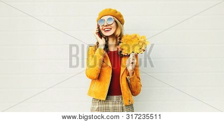 Autumn Portrait Smiling Woman Calling On Phone Holding Yellow Maple Leaves Wearing French Beret On C