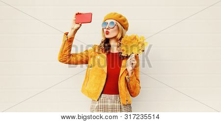 Autumn Mood! Woman Taking Selfie Picture By Phone Blowing Red Lips Sending Sweet Air Kiss Holding Ye