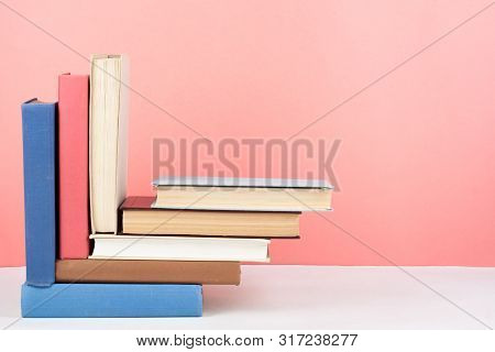 Open Book, Hardback Colorful Books On Wooden Table, Red, Pink Background. Back To School. Copy Space