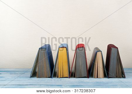 Book Stacking, Hardback Books On Wooden Table. Back To School. Copy Space For Text