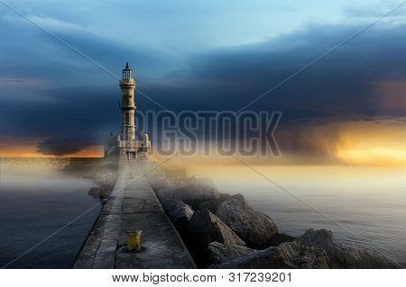 Mystical Seascape With A Lonely Lighthouse In The Fog On The Background Of A