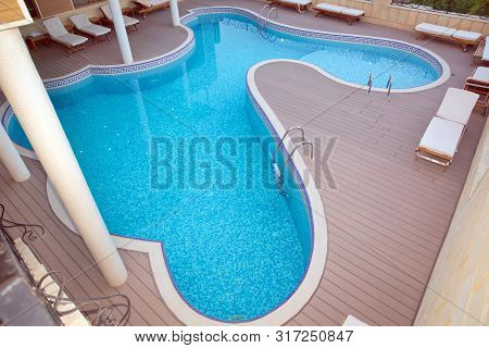 Bubble Pool 3 . View On Swimming Pool With Turquoise Clear Water . Swimming Pool With Bright Blue Wa