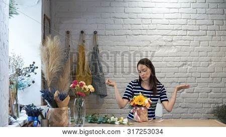 Portrait Of Woman Creating Flower Compositions..