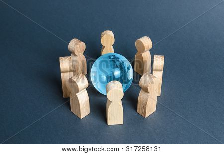 People Surrounded A Blue Glass Globe. Concept Of Cooperation And Collaboration Of People And Countri