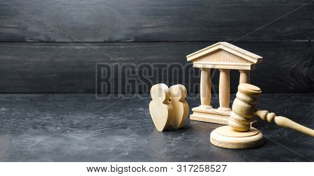 People Standing Near The House Of Government And Judge's Gavel. Concept Of The Judicial System And T