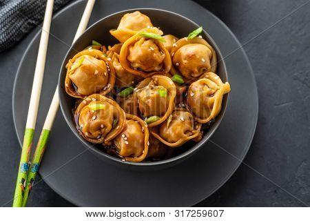 Asian Dumplings In Bowl, Chopsticks, Plates. Asian Table Setting. Chinese Dumplings For Dinner. Sele