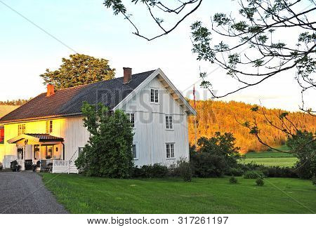 White Wooden Scandinavian House On Sunset
