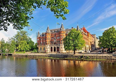 Facade Of Historical Building By The River In Orebro, Sweden.