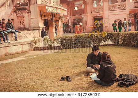 Varanasi. India: Couple Of Students Studing Outdoor In Campus Of Bannares Hindu University On Januar