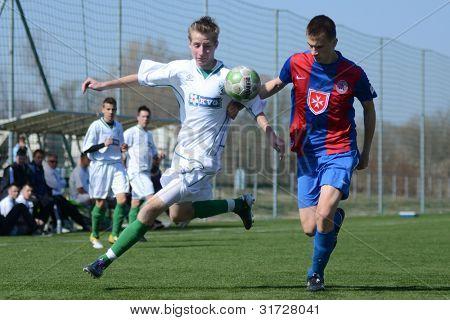 KAPOSVAR, HUNGARY - MARCH 17: Adam Hampuk (white) in action at the Hungarian National Championship under 18 game between Kaposvar (white) and Videoton (blue), March 17, 2012 in Kaposvar, Hungary.