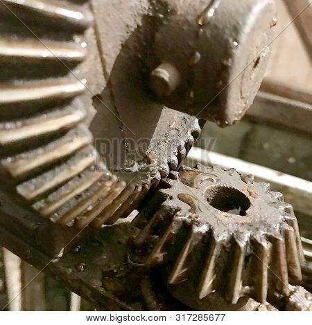 Large Gear Wheel Mechanism, Cogwheels In Style Steampunk. Cogwheels Consists Of Gear Metal Part On M