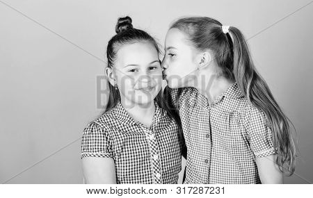 Nothing Like Sisterly Love. Adorable Girl Kissing Her Little Sister With Love. A Moment Of Pure Love