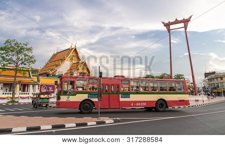 A Public Bus On Street At The Giant Swing Or Sao Ching Cha The  Landmark Of Bangkok City. Thailand: