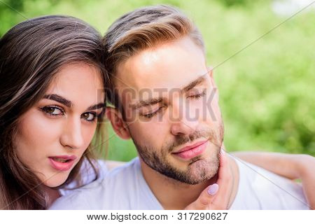 Sexual attraction. Relaxing with darling. Lovers cuddling. Couple in love. Trust and intimacy. Sensual hug. Love romance concept. Romantic date. Handsome man pretty girl in love. Attractive couple poster