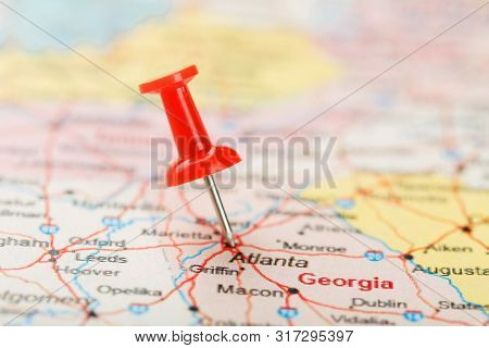 Red Clerical Needle On A Map Of Usa, South Georgia U.s. State And The Capital Atlanta. Close Up Map