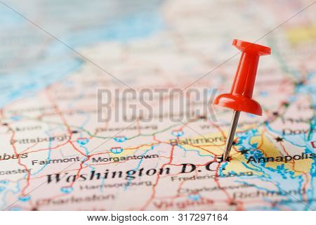 Red Clerical Needle On The Map Of Usa, South Washington, Dc And The Capital Of Richmond. Close Up Ma