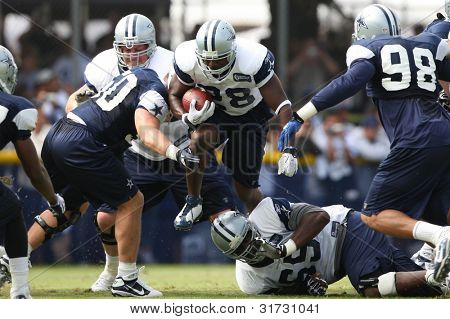 OXNARD, CA. - AUG 15: Dallas Cowboys RB (#28) Felix Jones breaks tackles during the second day of the 2010 Dallas Cowboys Training Camp on Aug 15 2010 in Oxnard, California.