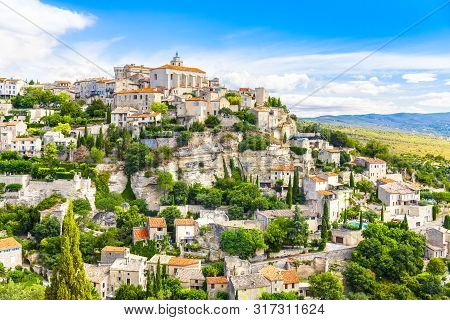 View Of Gordes, A Small Medieval Town In Provence, France. A View Of The Ledges Of The Roof Of This