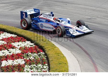 LONG BEACH - APRIL 17: Helio Castroneves driver of the #3 Auto Club of Southern California Team Penske Dallara Honda races during the IndyCar Series Toyota Grand Prix on April 17 2011 in Long Beach.