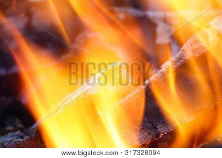 Glowing Embers In Hot Red Color, Abstract Background. The Hot Embers Of Burning Wood Log Fire. Firew