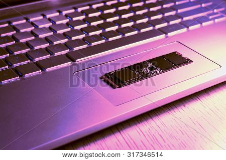 Fragment Of The Bottom Of The Netbook Diagonally. On The Trackpad Is Parallel To The Ssd Chip Of The