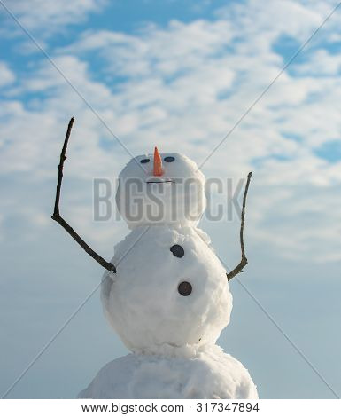 Funny Snowman In Stylish Hat And Scarf On Snowy Field. Snowman Wish You Merry Christmas. Handmade Sn