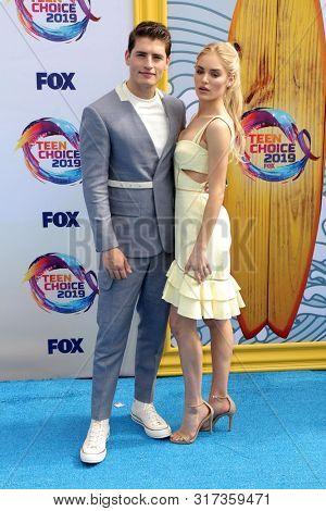 LOS ANGELES - AUG 11:  Gregg Sulkin, Michelle Randolph at the Teen Choice Awards 2019 at Hermosa Beach on August 11, 2019 in Hermosa Beach, CA