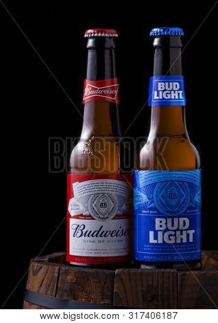 London, Uk - April 27, 2018: Glass Bottle Of Bud Light And Budweiser Original Beer On Top Of Old Woo