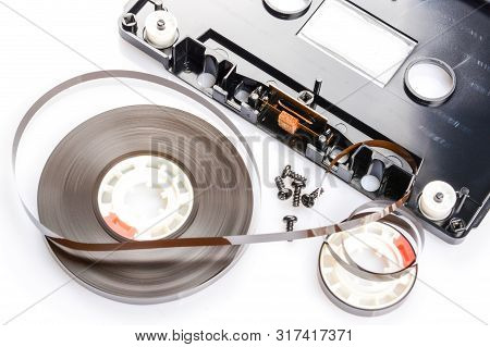 Disassembled Audio Compact Cassette. Audio Cassette With Tape As Security Mechanism With Cover Remov