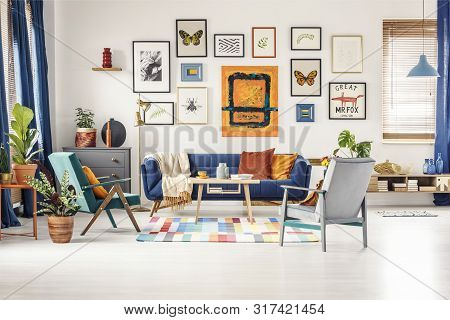 Simple Posters Gallery Hanging On The Wall In Bright Living Room
