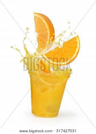 Orange Juice Splash With Oranges In A Plastic Cup