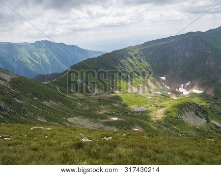 View From Ostry Rohac Peak On Western Tatra Mountains Or Rohace Panorama. Sharp Green Mountain Peaks