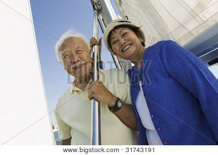Smiling Couple on Sailboat