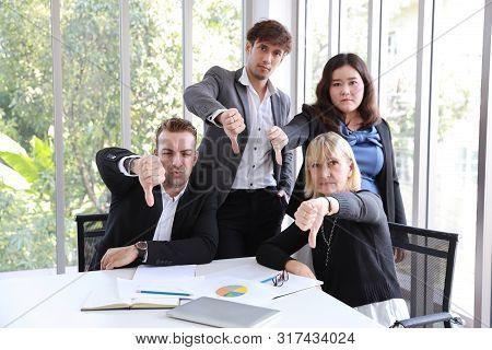 Caucasian Boss Businessman Showing Thumb Down Or Dislike With Unhappy Face With Unsuccess Multiethni