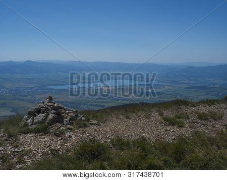 View On Valley Of Liptovsky Mikulas With Liptovska Mara Lake From Hiking Trail On Baranec Peak At We